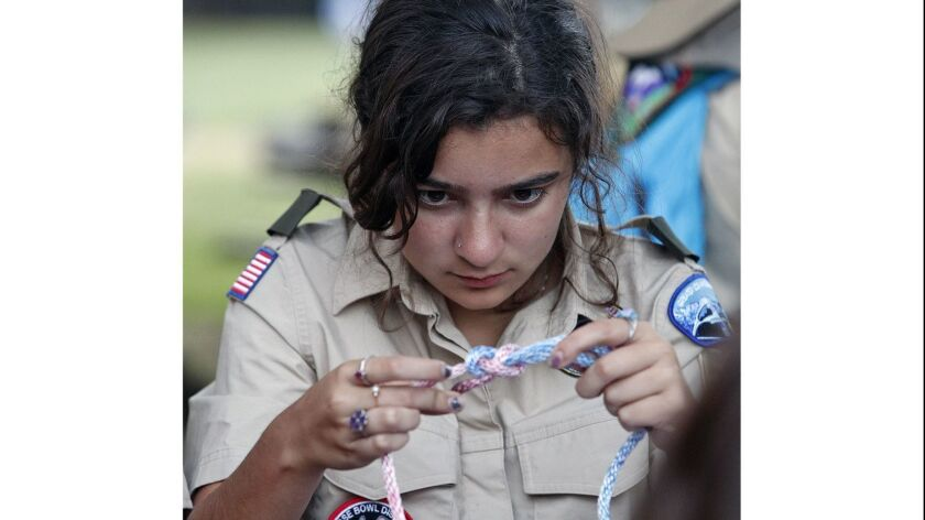 Scout Mathilda Barr, 15, of Los Angeles, ties one of the knots she will have to know to advance in r