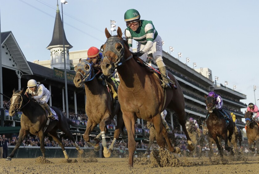 Joel Rosario rides Accelerate to victory in the Breeders' Cup Classic horse race at Churchill Downs,
