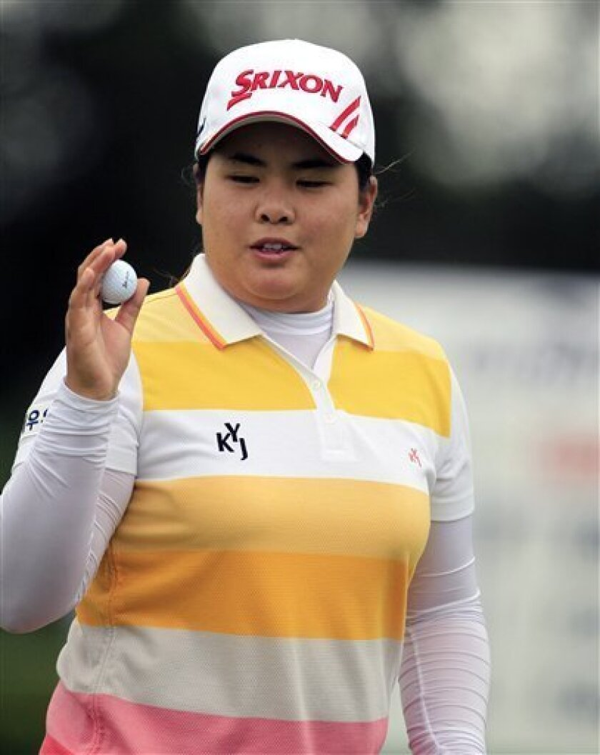 Inbee Park, of South Korea, acknowledges the crowd after her putt on the eighth green during the second round of the Jamie Farr Toledo Classic at the Highland Meadows Golf Club in Sylvania, Ohio, Friday, Aug. 10, 2012. (AP Photo/Carlos Osorio)