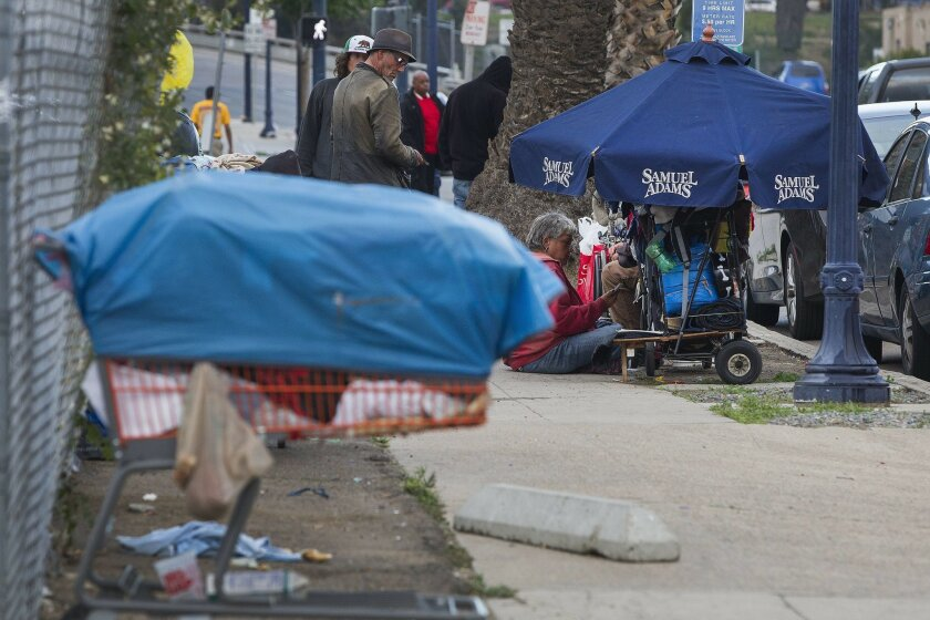 Homeless people camp out in downtown San Diego.