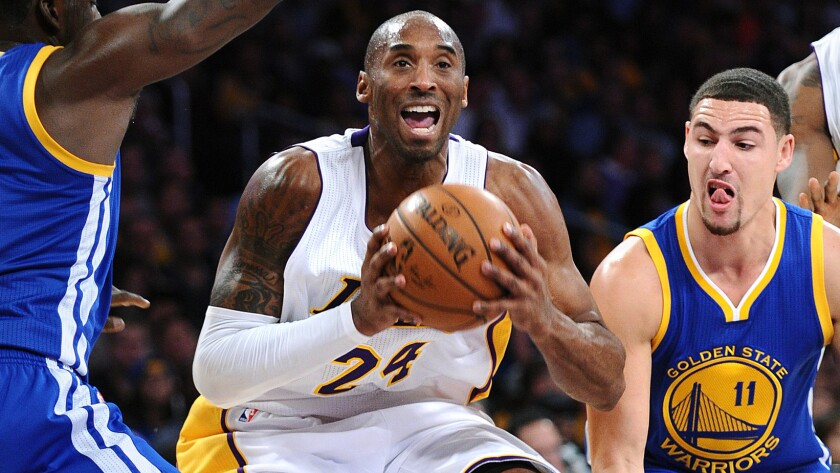 Lakers guard Kobe Bryant drives to the basket against Warriors guard Klay Thompson.