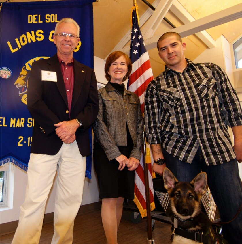 Del Sol Lions president David Cain, left, Judy Keene and Daniel Lopez, from Next Step Service Dogs, 4-month-old German Shepard Ringo – a Next Step Service Dogs dog-in-training. Photo courtesy of Paul McEneany