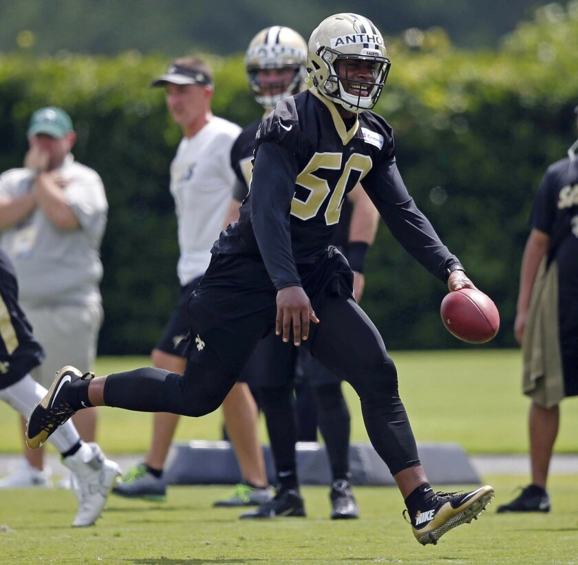 New Orleans Saints linebacker Stephone Anthony (50) goes through drills during NFL football practice in Metairie, La., Thursday, May 26, 2016. Anthony, a 2015 first-round pick who quickly took over as starting middle linebacker, is preparing for a position change. New Orleans plans to have free-age