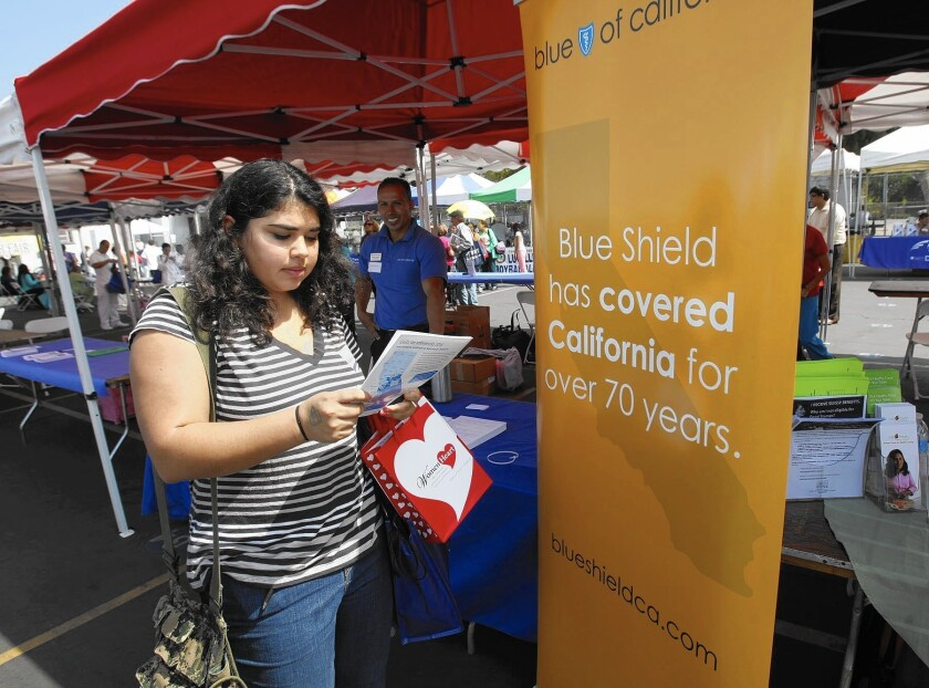 Blue Shield of California led the country with $107 million in profit on Obamacare policies sold to individuals. Kaiser Permanente was second with $66 million, and Anthem Blue Cross ranked seventh nationally with a $9-million surplus in the Covered California exchange. Above, Sophia Bracho gets information from Blue Shield of California in 2013.