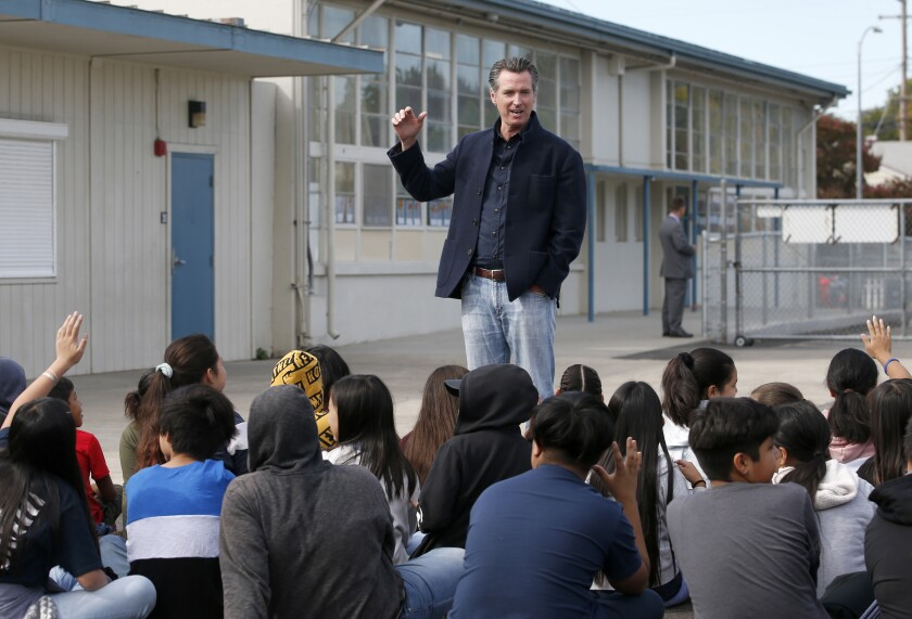 In this Oct. 7, 2019, file photo, California Gov. Gavin Newsom talks to students.