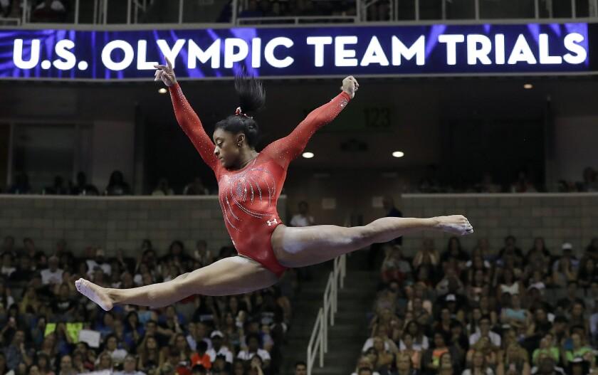 Virus Outbreak Olympic Loans Gymnastics