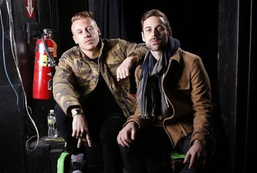 FILE - This Nov. 20, 2012 file photo shows Ben Haggerty, better known by his stage name Macklemore, left, and his producer Ryan Lewis at Irving Plaza in New York. The Recording Academy announced Wednesday, Oct. 8, 2013 that Drake, Robin Thicke and Macklemore & Ryan Lewis will perform at the Grammy