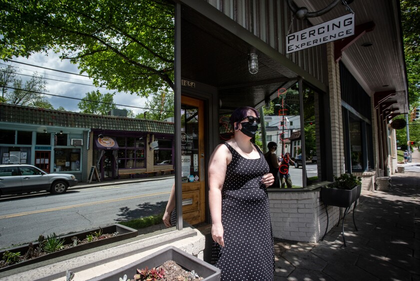 Christina Blossey, owner of a body piercing business, Piercing Experience, says her business is likely to remain closed until she can be assured that she can acquire masks and cleaning materials regularly to keep her customers safe.