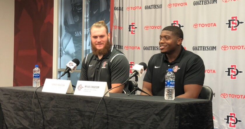 San Diego State tight end Parker Houston (left) and Myles Cheatum speak with the media during Tuesday's weekly press conference at the Fowler Athletics Center.