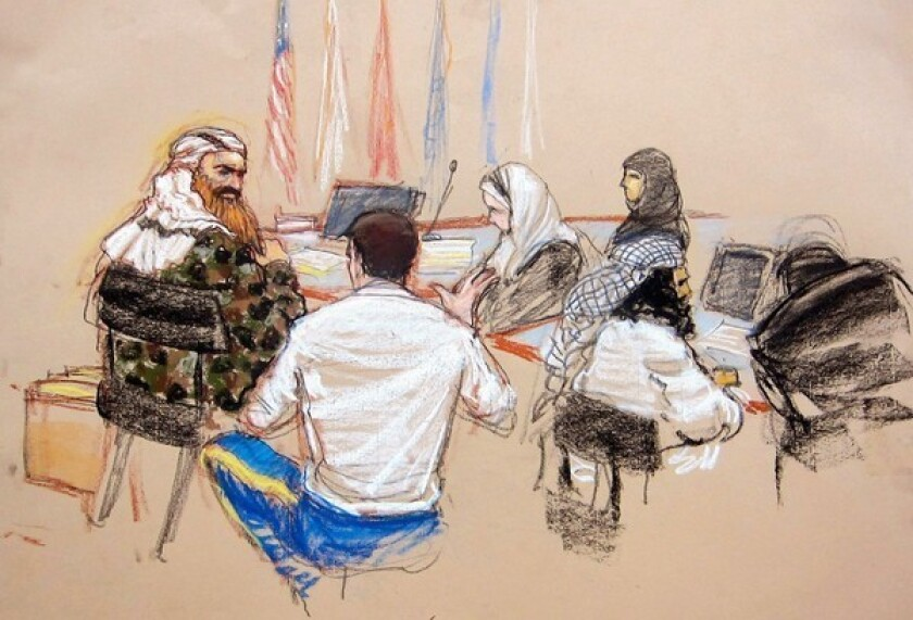 A courtroom sketch shows Khalid Shaikh Mohammed, left, conferring with his lawyer, Army Capt. Jason Wright, at a hearing at Guantanamo Bay.