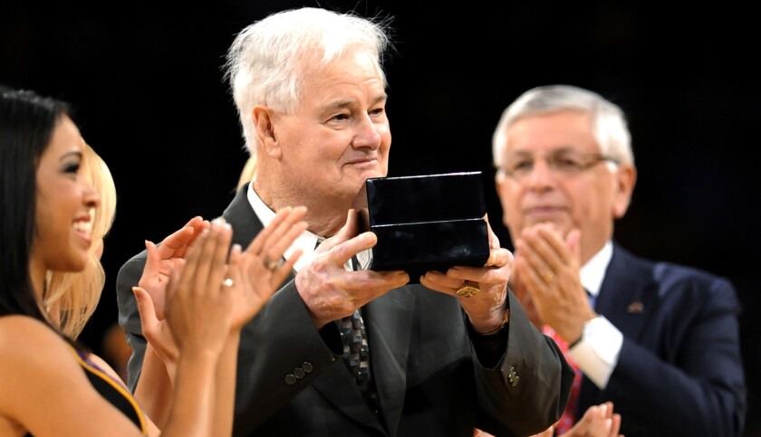 Then-Lakers assistant coach Tex Winter receives his 2009 NBA championship ring during a ceremony at Staples Center on Oct. 27, 2009.
