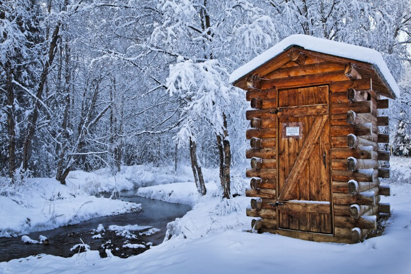 "A log outhouse at Chena Hot Springs Resort, about 60 miles northeast of Fairbanks, Alaska. It's one of the toilets featured in Lonely Planet's ""Toilets: A Spotter's Guide."""