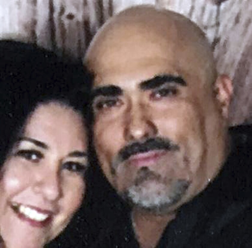This undated photo provided by the Reyna family shows Rafael Reyna and his wife, Christel. Bryan Sto