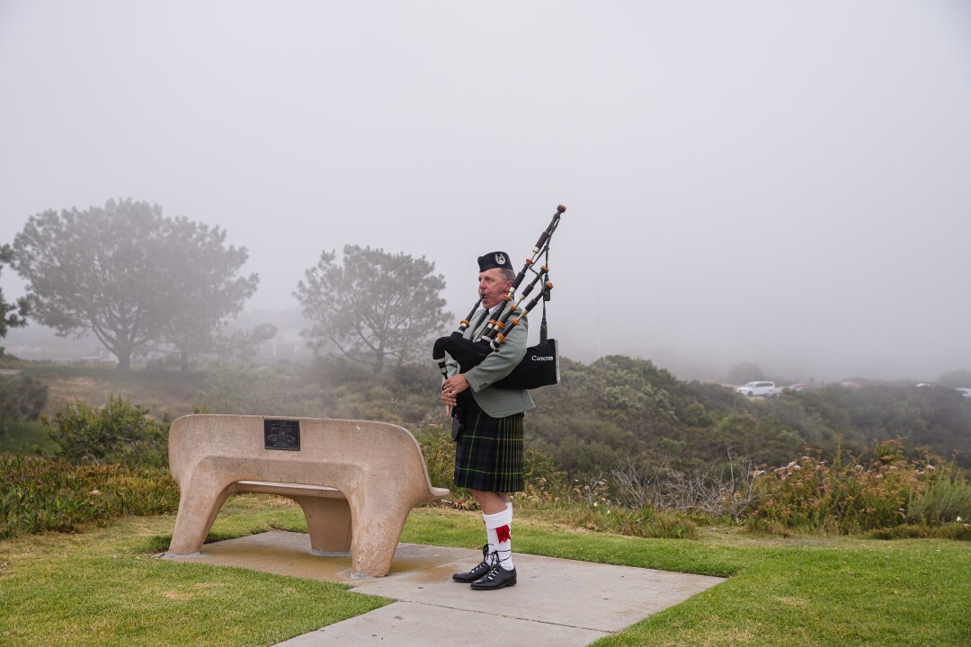 Ian Kelly plays music on his bagpipes before the Memorial Day service at Mt. Soledad National Veterans Memorial.