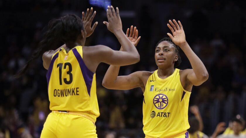 Sparks' Nneka Ogwumike, right, had 24 points, nine rebounds and five assists in the team's 78-66 win over the Atlanta Dream on Tuesday.