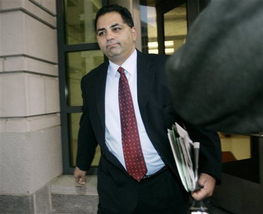 In this Friday, Oct. 27, 2006 file photo, former Bush administration official David Safavian leaves U.S. District Court in Washington. It's time for Round Two in the Justice Department's prosecution of David Safavian, the only person convicted by a jury of corruption charges in the Jack Abramoff lobbying scandal and the only one whose conviction has been overturned on appeal. (AP Photo/Charles Dharapak)