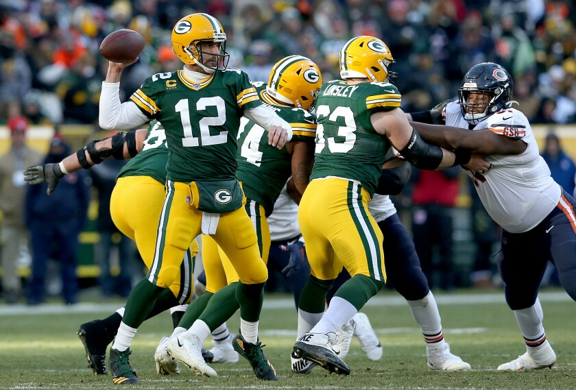Packers quarterback Aaron Rodgers passes against the Chicago Bears on Sunday.