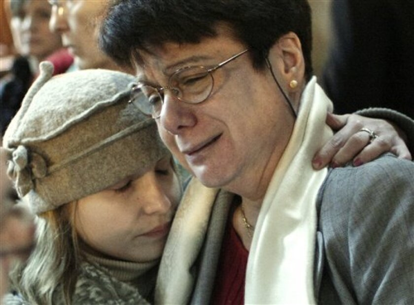 Michele Jolivet, right, who lost her son Emmanuel, is comforted as she cries at the courthouse, after a Paris court acquitted six people Wednesday, Jan. 14, 2009, over the deaths of at least 114 people who contracted a brain-destroying disease after being treated with tainted human growth hormones.