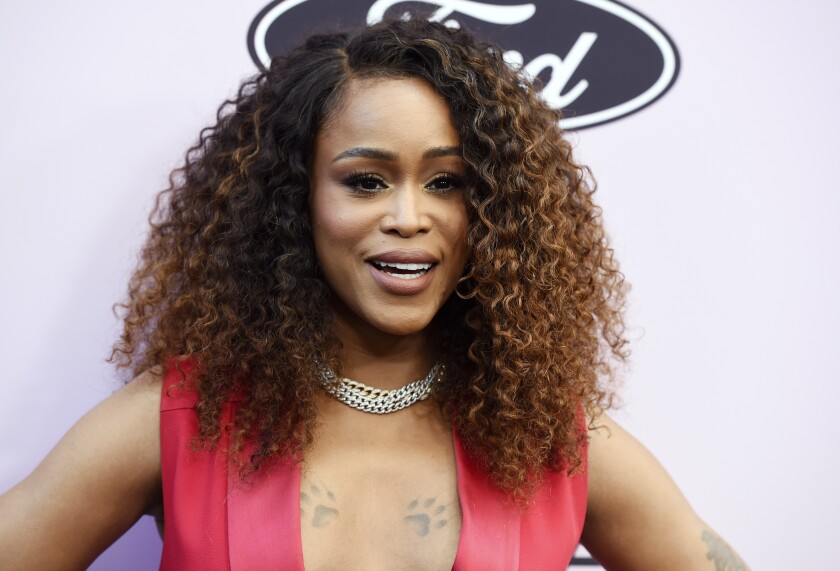 """FILE - Eve poses at the 13th annual ESSENCE Black Women in Hollywood Awards Luncheon on Feb. 6, 2020, in Beverly Hills, Calif. The actor, singer and host of """"The Talk"""" said she's leaving the show in December to focus on expanding her family. (AP Photo/Chris Pizzello, File)"""