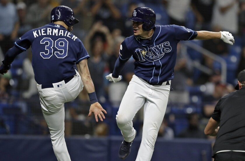 Tampa Bay Rays' Willy Adames, right, celebrates with Kevin Kiermaier after hitting a two-run home run off Boston Red Sox relief pitcher Bobby Poyner during the fourth inning of a baseball game Monday, Sept. 23, 2019, in St. Petersburg, Fla. (AP Photo/Chris O'Meara)