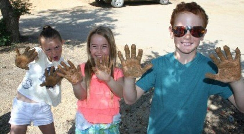 R. Roger Rowe School third-graders recently participated in a field trip at the Osuna Adobe and made their own adobe bricks.