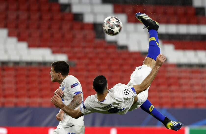 Porto's Mehdi Taremi scores his side's opening goal during the Champions League quarter final second leg soccer match between Chelsea and Porto at the Ramon Sanchez Pizjuan stadium, in Seville, Spain, Tuesday, April 13, 2021. (AP Photo/Angel Fernandez)