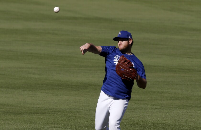 Dodgers first baseman Max Muncy warms up during practice at Dodger Stadium on July 3.