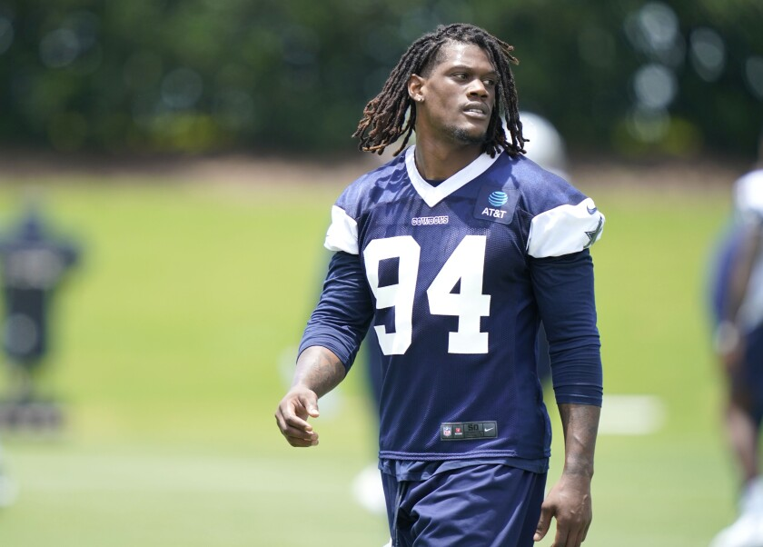 In this photo made Tuesday, June 8, 2021, Dallas Cowboys defensive end Randy Gregory (94) walks the field during an NFL football team practice, in Frisco, Texas. Gregory isn't ashamed of a suspension-filled past that nearly derailed his NFL career, just maybe a little tired of it being the focus of his story. (AP Photo/LM Otero)