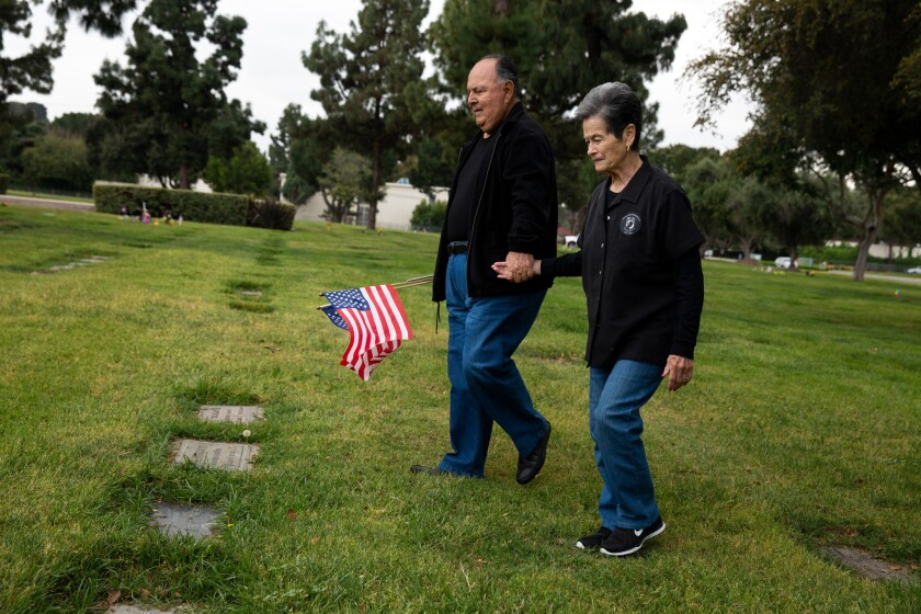 LOS ANGELES, CA-APRIL 16, 2019: Ruben and Emily Valencia visit the grave site where Raul Guerra, Val