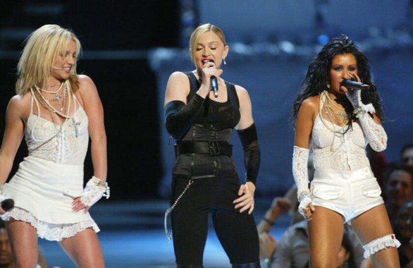Britney Spears, Madonna and Christina Aguilera perform onstage during the 2003 MTV Video Music Awards at Radio City Music Hall on August 28, 2003 in New York City.