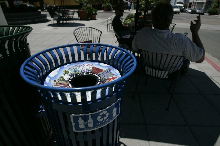 Expanded recycling programs, including new collection bins in Little Italy, have helped the city keep improving its diversion rate of materials away from the landfill.