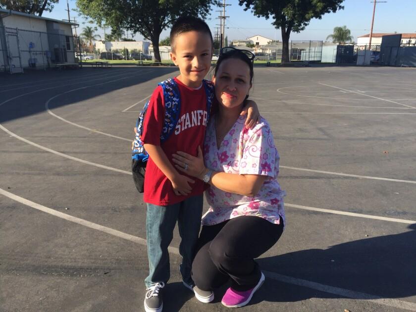 Alma Falcon drops off her son, Daniel, at Fourth Street Elementary School in East Los Angeles.