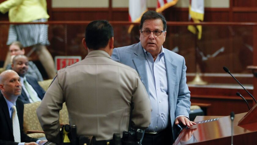Former San Diego city attorney Mike Aguirre is asked to leave the podium after his time expired whil