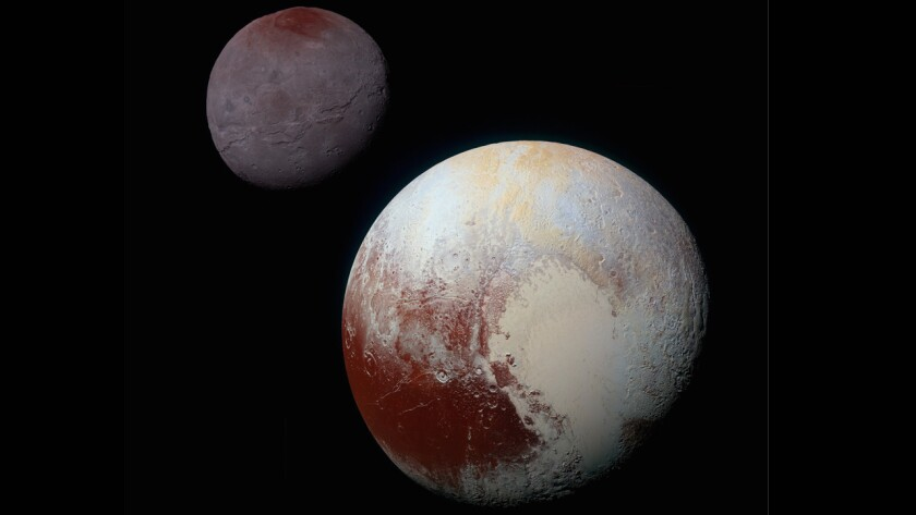 This composite of enhanced color images of Pluto, lower right and Charon was taken by NASA's New Horizons spacecraft as it passed through the Pluto system on July 14, 2015.