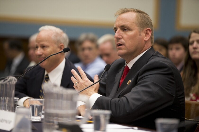 Rep. Jeff Denham (R-Turlock), right, shown in 2013, is pushing to sell empty federal buildings across the country.