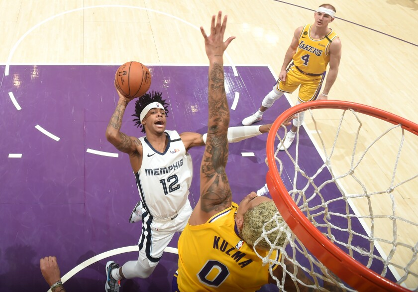 Lakers forward Kyle Kuzma tries to block the shot of Memphis Grizzlies rookie Ja Morant on Feb. 21 at Staples Center.