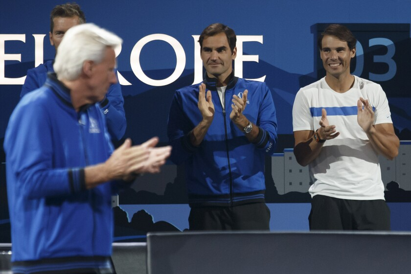 Team Europe's Captain, Bjorn Borg, left, with Team Europe's players Roger Federer, center, and Rafael Nadal, right, applaude at the Laver Cup tennis event in Geneva, Switzerland, Saturday, Sept. 21, 2019. (Salvatore Di Nolfi/Keystone via AP)
