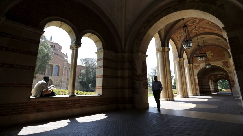 WESTWOOD, CA -- WEDNESDAY, APRIL 13, 2016: A student studies in the archway of Royce Hall at UCLA in