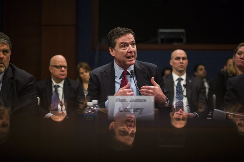 FBI Director James Comey speaks during a hearing before the House Select Intelligence Committee on Feb. 25.