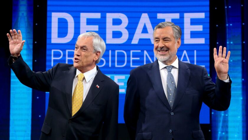 Sebastian Pinera, left, and Alejandro Guillier before the start of a presidential debate Dec. 11 in Santiago, Chile.