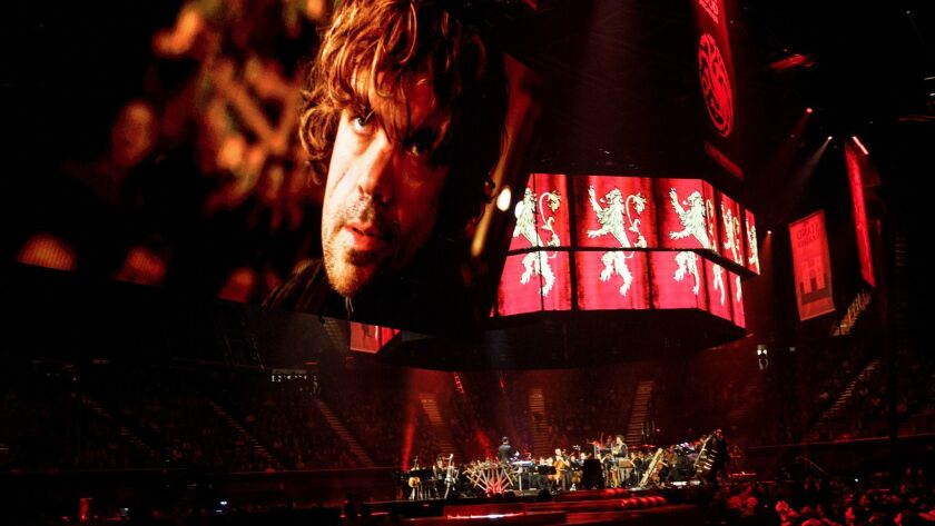 """Screens project """"Game of Thrones"""" character Tyrion Lannister (Peter Dinklage) to music during the Game of Thrones Live Concert Experience performance led by composer Ramin Djawadi at the Forum in Inglewood. (Patrick T. Fallon / For The Times)"""