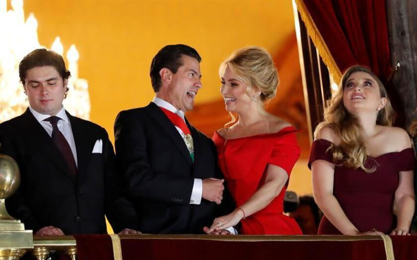Former Mexican President Enrique Peña Nieto (c-left), and his wife, Angelica Rivera (c-right), participate together with their children on Sep. 15, 2018, during the celebration of Mexican Independence in Mexico City, Mexico. EPA-EFE / Jorge Nunez / FILE