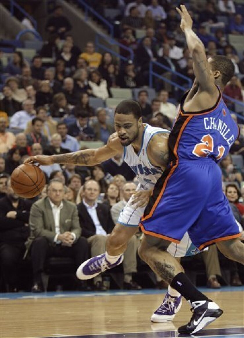 New Orleans Hornets center Tyson Chandler tries to drive past New York Knicks forward Wilson Chandler in the first half of an NBA basketball game in New Orleans on Monday, Jan. 12, 2009. (AP Photo/Alex Brandon)