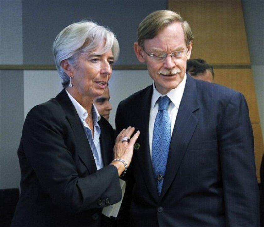 World Bank President Robert Zoellick, right, and French Finance Minister Christine Lagarde, talk before signing a loan agreement between the French Development Agency and the International Bank for Reconstruction and Development, Friday, Oct. 8, 2010, at the World Bank in Washington. (AP Photo/Manuel Balce Ceneta)