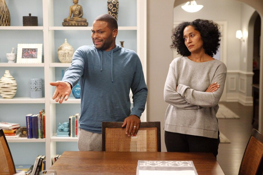 "In this image released by ABS, Anthony Anderson, left, and Tracee Ellis Ross appear in a scene from ""Black-ish."" The series was created by Kenya Barris, who was motivated to write the comedy about an African-American family's efforts to honor its heritage in part by the unreality of what he grew up"