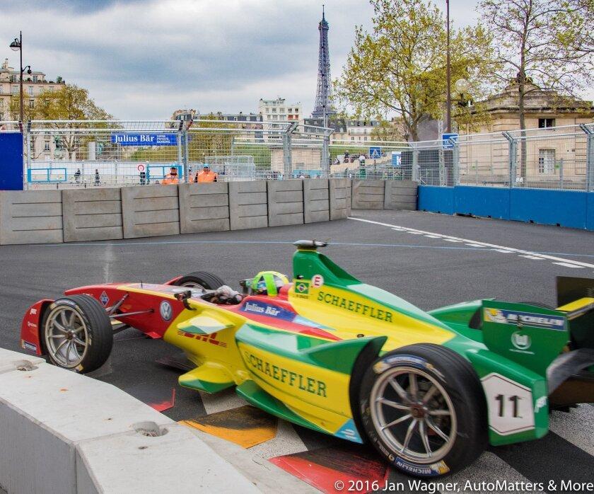 Eventual Paris ePrix winner Lucas di Grassi at the foot of the Eiffel Tower