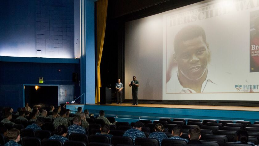 Former football star Herschel Walker, national spokesperson for the Patriot Support Program, speaks to sailors at at Naval Air Station North Island on Nov. 3. The program aids sailors who suffer from depression, addiction, or other behavioral health issues.