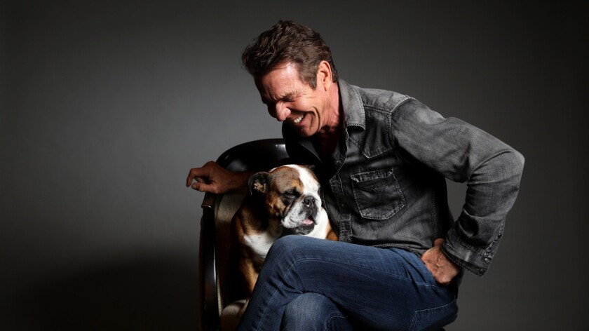 LOS ANGELES, CALIF. -- SUNDAY, MAY 5, 2019: Dennis Quaid and his miniature English bulldog, Peaches.