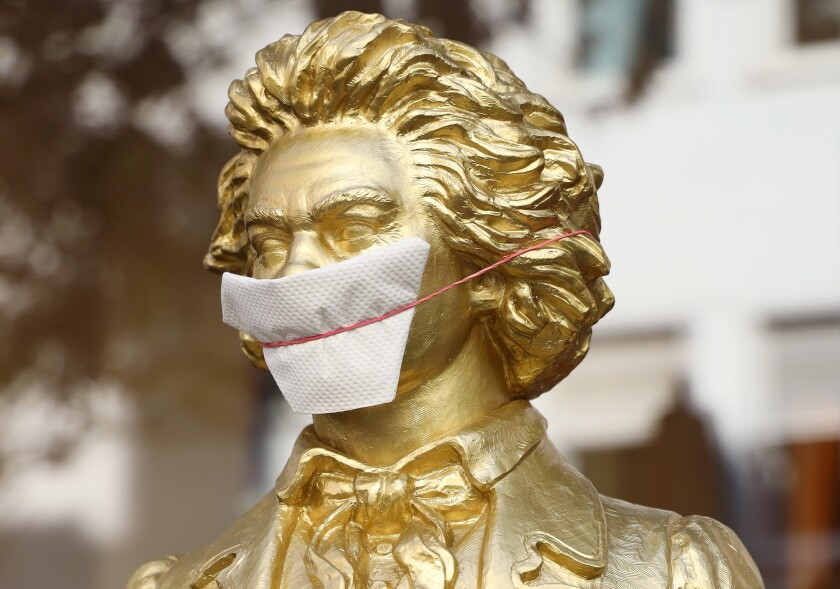 A statue of Beethoven in Bonn, Germany, gets a homemade mask.