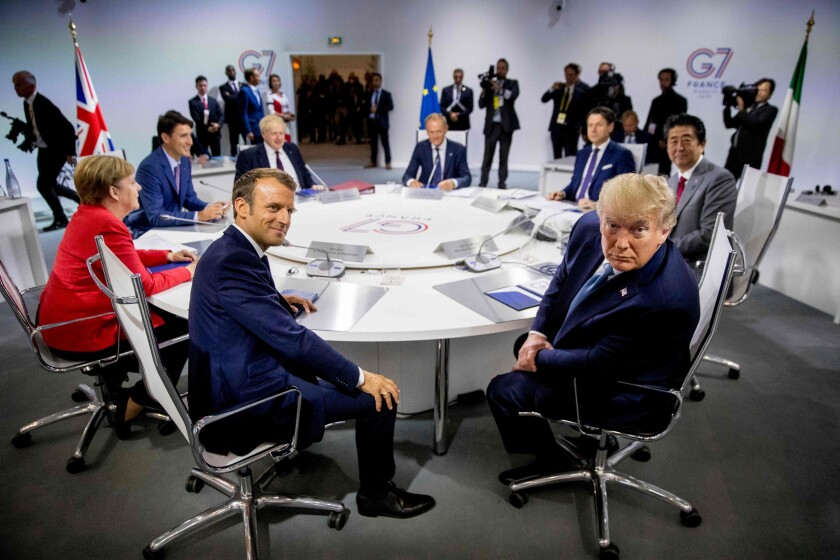 President Trump leans in his chair during a meeting with other world leaders at the G7 summit in France on Aug. 25.